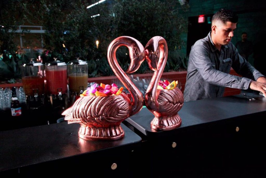 Two rose gold swans filled with the Palm Royal best cocktail in Vegas