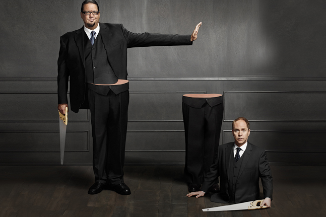 Magicians Penn and Teller cut in half