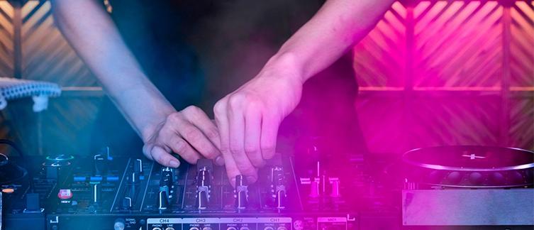 A DJ using a mixer